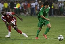 <p>A seleção nacional iraquiana venceu a Palestina por 4 x 0 nesta segunda-feira na primeira partida internacional disputada em Bagdá desde a invasão liderada pelos Estados Unidos em 2003. REUTERS/Thaier al-Sudani (IRAQ SPORT SOCCER)</p>