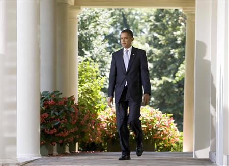 U.S. President Barack Obama walks out of the Oval Office before speaking about health care reform in the Rose Garden of the White House in Washington July 15, 2009. REUTERS/Larry Downing