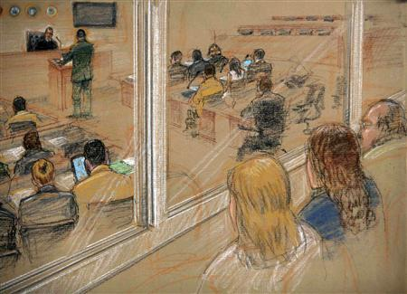 In this photo of a sketch by a courtroom artist, and reviewed by the U.S. military, family members of victims of the September 11, 2001 attacks, (R) observe courtroom proceedings during hearings for the five alleged September 11 co-conspirators, inside the courthouse at the Camp Justice compound for the U.S. war crimes commission, at Guantanamo Bay U.S. Naval Base, July 16, 2009. REUTERS/Janet Hamlin/Pool