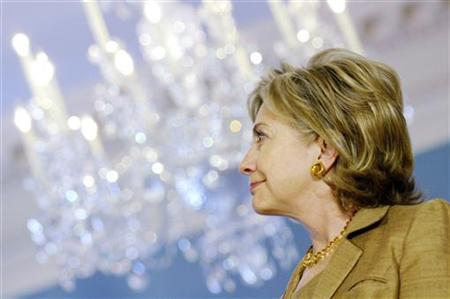 Secretary of State Hillary Clinton appears before reporters after welcoming Foreign Minister of Latvia Maris Riekstins at the State Department, July 14, 2009. REUTERS/Jonathan Ernst