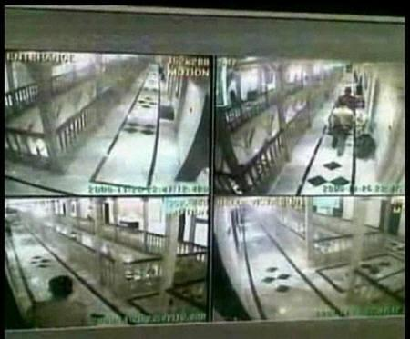 A frame grab from CCTV footage, released December 7, 2008, taken inside the Taj Mahal Hotel in Mumbai shows suspected militants (top right) and security personnel (bottom left) walking along corridors of the hotel in Mumbai on November 26, 2008. REUTERS/via REUTERS TV