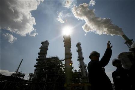 An engineering department process design manager for the Valero St. Charles Oil Refiner, is seen in silhouette during a tour of the refinery in Norco, Louisiana, August 15, 2008. REUTERS/Shannon Stapleton