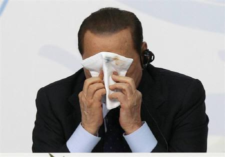 Italian Prime Minister Silvio Berlusconi wipes his face during the ''Milano Med Forum 2009'' in downtown Milan July 20, 2009. REUTERS/Alessandro Garofalo