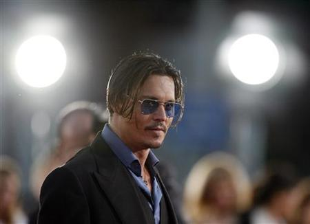 Cast member Johnny Depp poses at the premiere of the movie ''Public Enemies'' at the Mann Village theatre in Westwood, California June 23, 2009. REUTERS/Mario Anzuoni