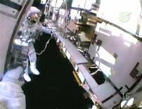 <p>Astronaut Chris Cassidy is seen in this view from the helmet camera of fellow spacewalker Dave Wolf as the pair work outside the International Space Station in this image from NASA TV July 22, 2009. REUTERS/NASA TV</p>