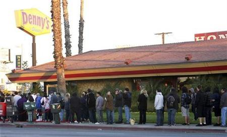 Hundreds of people wait in line at a Denny's in North Hollywood, California for a Free Grand Slam breakfast February 3, 2009. REUTERS/Rene Macura/Handout