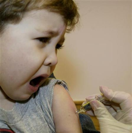 Four year-old Jonathan Nies reacts as he receives a flu vaccination at Children's Hospital Boston in Boston, December 12, 2003. REUTERS/Brian Snyder