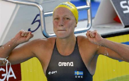 Sarah Sjostrom of Sweden celebrates after setting a world record in the women's 100m butterfly swimming final at the World Championships in Rome July 27, 2009. REUTERS/Max Rossi