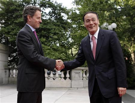 Treasury Secretary Timothy Geithner (L) greets Chinese Vice Premier Wang Qishan as he arrives at the Economic Track Opening Session of the U.S.-China Strategic and Economic Dialogue at the Treasury Department in Washington July 28, 2009. REUTERS/Yuri Gripas
