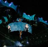 <p>U2 singer Bono is seen on video screens during the second concert of the U2 360º Tour at Camp Nou Stadium in Barcelona July 2, 2009. REUTERS/Albert Gea</p>