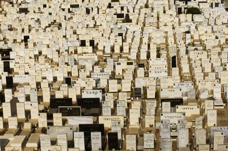 Graves are seen at the Tel Aviv cemetery of Kiryat Shaul July 28, 2009. REUTERS/Gil Cohen Magen