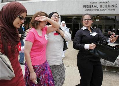 The mother of Ziyad Yaghi (2nd L) is consoled as she leaves the Terry Sanford Federal Building and Courthouse in Raleigh, North Carolina during a lunchtime recess from a detention hearing for seven alleged terrorist suspects August 4, 2009. REUTERS/Ellen Ozier