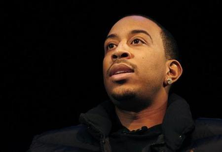 Hip-hop artist Ludacris answers a question at a symposium on hip-hop at Howard University in Washington January 19, 2009. REUTERS/Jessica Rinaldi