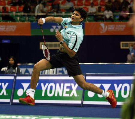 India's Chetan Anand returns a shot against Korea's Ji Hoon Hong during their singles match against in preliminary round of the World Badminton Championships in Hyderabad August 10, 2009. REUTERS/Arko Datta