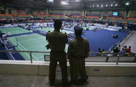 Policemen stand guard inside the stadium during the World Badminton Championships in Hyderabad August 10, 2009. A Malaysian coach was quarantined with swine flu symptoms at the world badminton championships on Tuesday, while a doubles pair from Thailand pulled out of a match after one of them complained of fever. REUTERS/Arko Datta