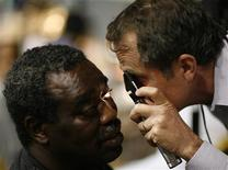 <p>Optometrist Greg Pearl (R) inspects the eye of Kenneth Spann at the Remote Area Medical (RAM) health clinic in Inglewood, California August 11, 2009.</p>