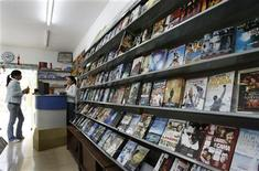 <p>Shopkeepers wait for customers at a store selling pirated DVDs in Beijing April 24, 2007. REUTERS/Claro Cortes IV</p>