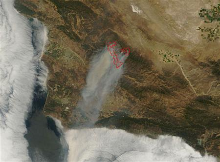The La Brea Fire in southern California is pictured in this image taken August 12, 2009 by NASA's Terra satellite, and released August 17. REUTERS/NASA/MODIS Rapid Response Team/Handout