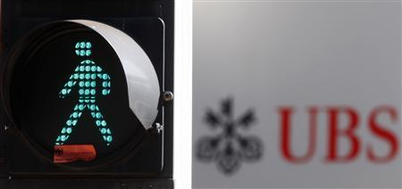 A traffic sign is seen next to an UBS logo in Zurich August 19, 2009. REUTERS/Christian Hartmann