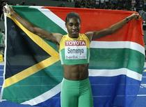 <p>Caster Semenya of South Africa celebrates after winning the women's 800 metres final during the world athletics championships at the Olympic stadium in Berlin August 19, 2009. REUTERS/Dominic Ebenbichler</p>