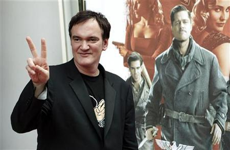 Director Quentin Tarantino arrives for a screening of his new film ''Inglourious Basterds'' in Toronto, August 12, 2009. REUTERS/Mark Blinch