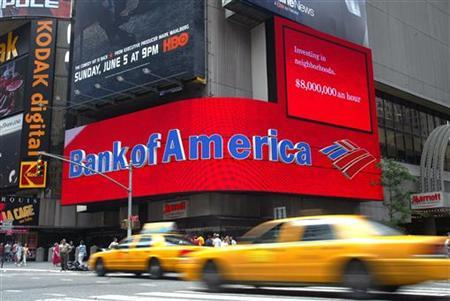 Taxis pass the Bank of America branch in New York's Times Square June 30, 2005. REUTERS/Shannon Stapleton