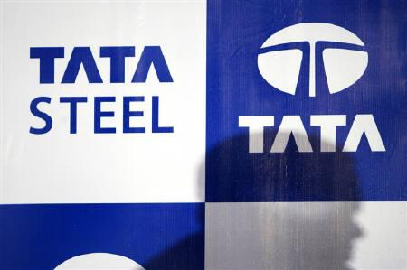 Shadow of an official of Tata Steel Ltd., falls on the company logo while presenting the company's quarterly results in Mumbai in this May 17, 2007 file photo. REUTERS/Arko Datta/Files