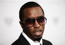 "<p>Rapper Sean Diddy Combs arrives for a screening of the film ""The September Issue"" in New York August 19, 2009. REUTERS/Lucas Jackson</p>"