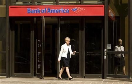 A woman walks out of a Bank of America branch in Charlotte, North Carolina July 17, 2009. B REUTERS/Chris Keane