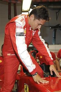 Italian Formula One driver Giancarlo Fisichella gets into his Ferrari F60 racing car during his first day with his new team at Fiorano track in central Italy September 3, 2009. REUTERS/Ferrari/Ercole Colombo/Handout