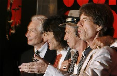 Rolling Stones band members Keith Richards (2nd R), Mick Jagger (R), Ronnie Wood (2nd L) and Charlie Watts smile as they arrive at the premiere of the documentary film ''Shine A Light'' about them directed by Martin Scorsese in New York March 30, 2008. REUTERS/Lucas Jackson