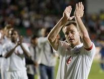 <p>John Terry, capitão da Inglaterra, quer garantir logo vaga para a Copa de 2010 REUTERS/Shamil Zhumatov</p>