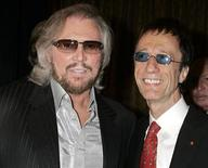 <p>Barry Gibb (L) and brother Robin Gibb pose as their group The Bee Gees was honored as BMI Icons at the 55th Annual Broadcat Music Industries (BMI) Pop Awards in Beverly Hills, California May 15, 2007. REUTERS/Fred Prouser</p>