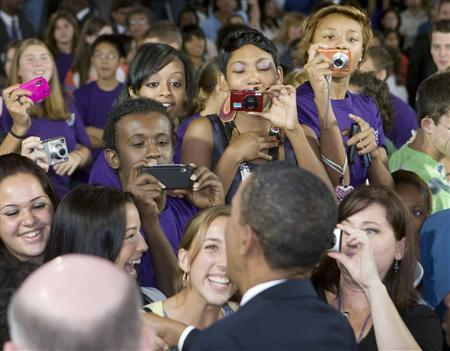 U.S. President Barack Obama meets students after he speaks about the importance of education while at an event at Wakefield High School in Arlington, Virginia, September 8, 2009. REUTERS/Larry Downing