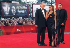 <p>U.S. actor Nicolas Cage (R), actress Eva Mendes (C) and German director Werner Herzog arrive on the red carpet during the 'Bad Lieutenant: Port Of Call New Orleans' premiere at the 66th Venice Film Festival September 4, 2009. REUTERS/Alessandro Bianchi</p>