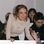 <p>Actress Lindsay Lohan talks to the media before the Charlotte Ronson collection show at New York Fashion Week February 13, 2009. REUTERS/Carlo Allegri</p>
