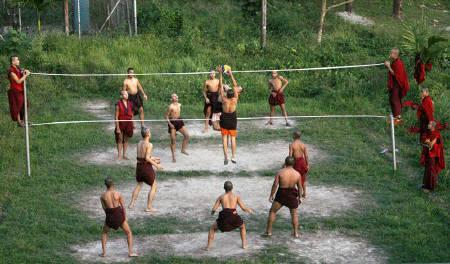 Monks play volleyball at Rabdey Dratsang in the southeastern district of Samdrup Jongkhar in Bhutan September 3, 2009. REUTERS/Singye Wangchuk