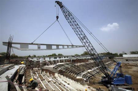 Labourers work at the National Stadium, one of the venues for the New Delhi Commonwealth Games August 24, 2009. REUTERS/Parth Sanyal/Files