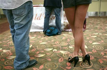 People wait in line to speak with recruiting representatives during a job fair in San Francisco, California, July 20, 2009. REUTERS/Robert Galbraith