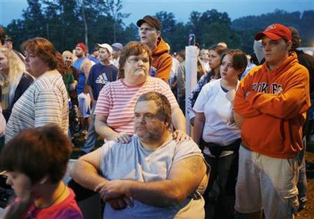 People wait in line to enter a free health clinic at the Wise County Fairgrounds in Wise, Virginia, July 25, 2009. REUTERS/Shannon Stapleton