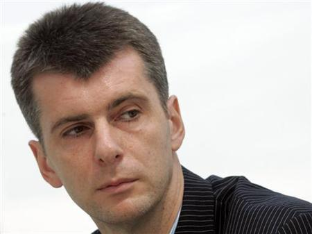 Russian billionaire Mikhail Prokhorov listens to a question during a news conference in Moscow, May 31, 2007. REUTERS/Sergei Karpukhin