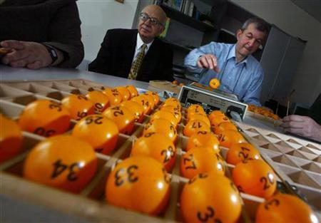 An official prepares lottery balls at the Bulgarian Sports Totalizer building in Sofia, February 27, 2005. REUTERS/Stoyan Nenov