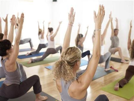 People participate in a YogaWorks class in Santa Monica, California in this handout picture taken early 2009. REUTERS/Handout