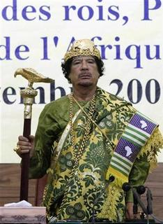 Libya's leader Muammar Gaddafi arrives to attend an event marking the 10th anniversary of the Sirte declaration, in which African countries decided to establish the African Union, in Tripoli September 9, 2009. REUTERS/Ismail Zetouny