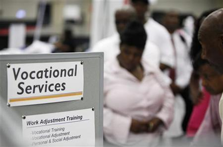 Applicants line up at a booth offering vocational services at a career fair held as part of the National Urban League's Economic Empowerment Tour in Dallas, Texas June 13, 2009. REUTERS/Jessica Rinaldi