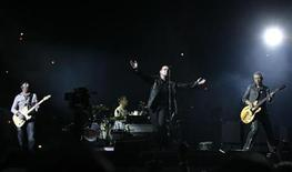 <p>U2's (L to R) lead guitarist The Edge, drummer Larry Mullen Jr., lead singer Bono, and bass guitarist Adam Clayton perform during the opening night of the North American leg of their 360 degree tour at Soldier Field in Chicago, September 12, 2009. REUTERS/Jeff Haynes</p>