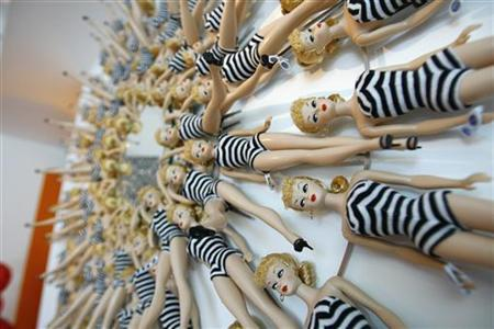 A wall mirror, by interior designer Jonathan Adler, realized using 65 reproduction dolls of the original 1959 Black and White Bathing Suit model, is pictured at a Barbie's 50th birthday party at the Barbie's real-life Malibu Dream House in Malibu, California March 9, 2009. REUTERS/Mario Anzuoni