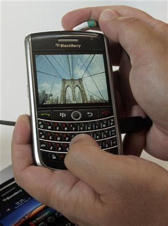 The new Research in Motion (RIM) BlackBerry Tour 9630 is shown at the annual general meeting of shareholders in Waterloo, Ontario, July 14, 2009 file photo. REUTERS/ Mike Cassese