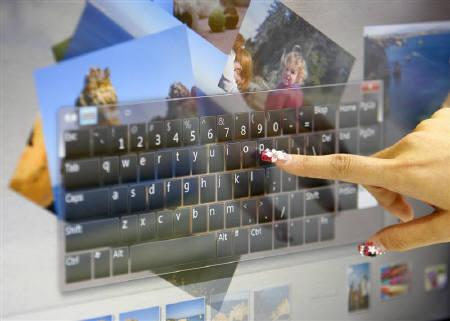 A model poses with a Microsoft Multi-Touch-enabled computer installed with Windows 7 during the 2009 Computex exhibition in Taipei in this June 2009 file photo. REUTERS/Nicky Loh