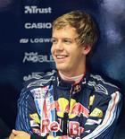 <p>O piloto alemão Sebastian lidera os treinos para o GP de Cingapura REUTERS/Joachim Herrmann</p>
